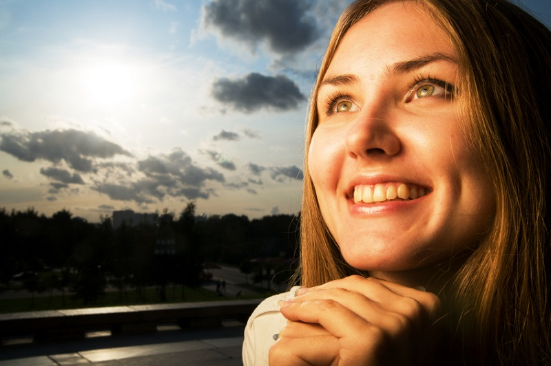 Young woman smiling at sunset